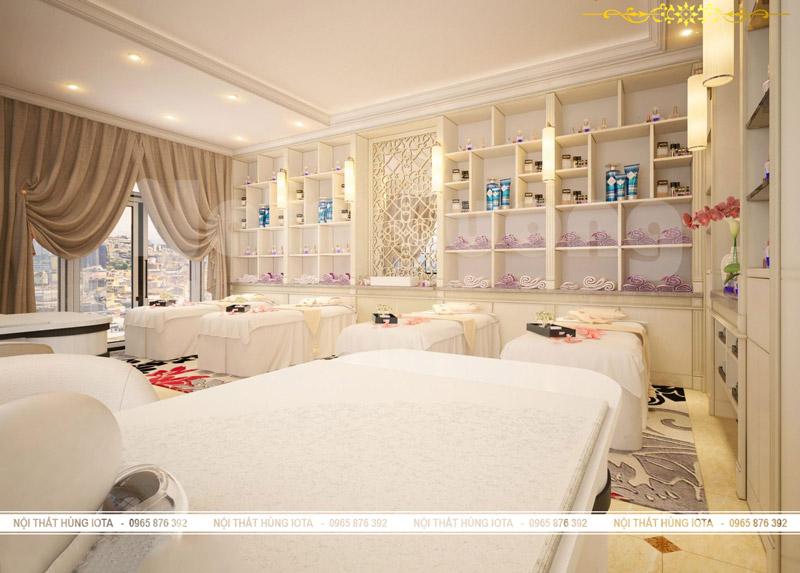 Giường spa trắng sữa và tủ trưng bày đựng sản phẩm spa có đèn