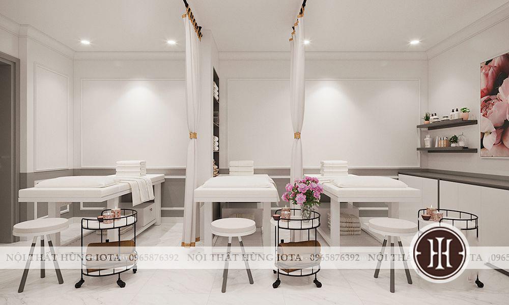 Giường spa màu trắng lắp đặt cho phòng điều trị spa