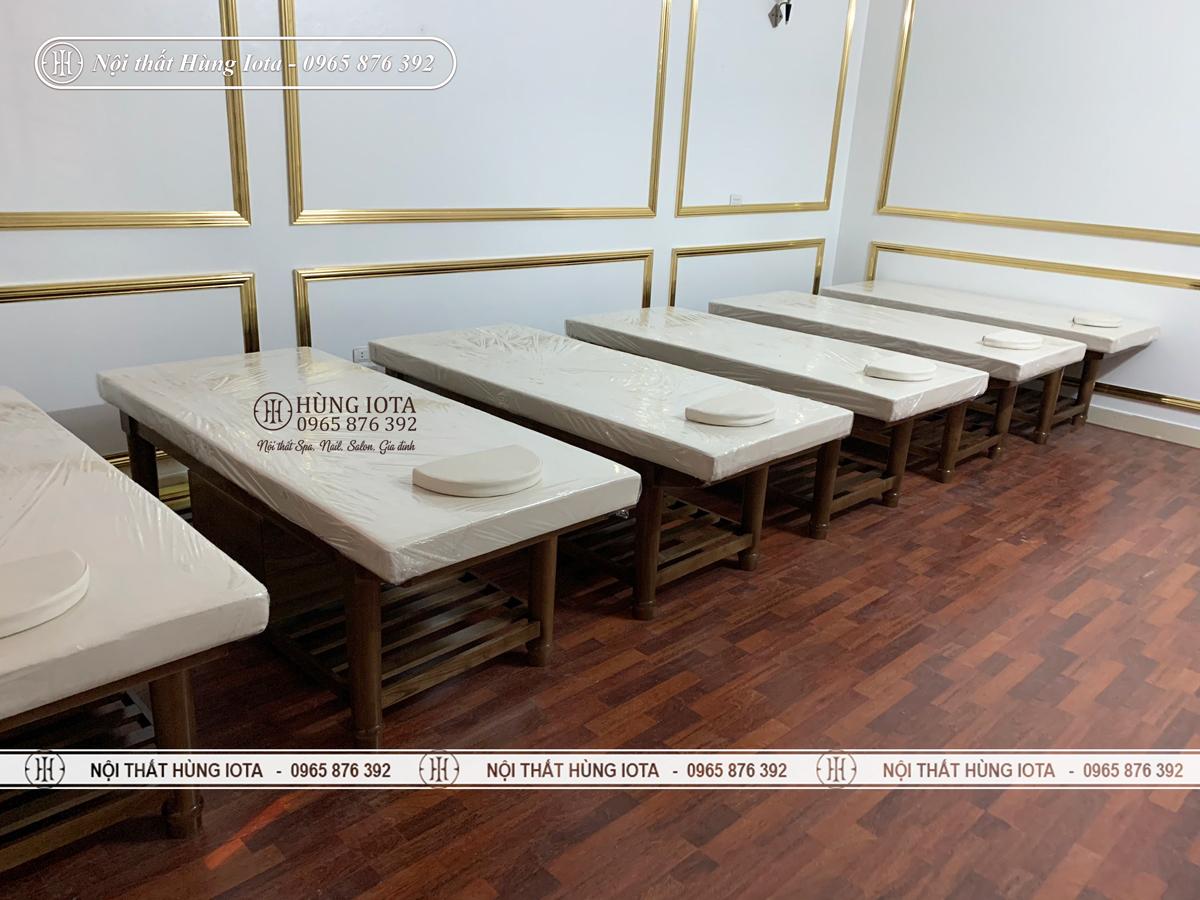 Giường massage gỗ sồi chân tiện tròn ở Bắc Ninh