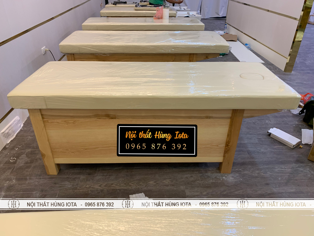 Giường spa màu vàng gỗ có tủ kín bên dưới màu vàng
